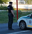 Slovak police car and police officer on duty (cropped).JPG