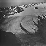 Snow River Glacier, terminus of valley glacier with firn line in the midground, September 3, 1977 (GLACIERS 6861).jpg