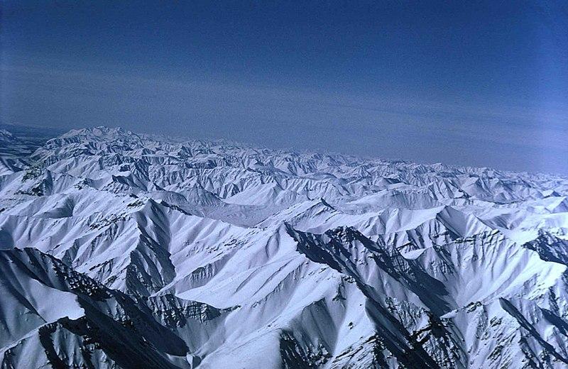 File:Snow covered mountain peaks.jpg