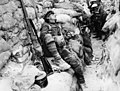 Soldier's comrades watching him as he sleeps, Thievpal, France, during World War I (3012796098).jpg