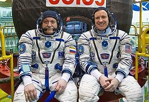 Soyuz MS-04 - Image: Soyuz MS 04 crew in front of their spacecraft