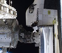 Space Shuttle docked to station - cropped and rotated.jpg