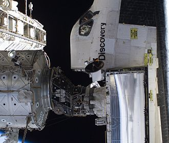 Pressurized Mating Adapter - Space Shuttle Discovery docked to one of the ISS's PMAs