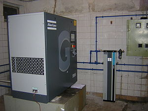 Rotary-screw compressor - Rotary-screw air compressor in a housing for sound attenuation
