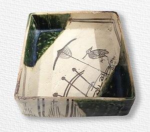 Ao (color) - Ao-Oribe ware dish, stoneware with iron-oxide decoration under copper-oxide glaze, Momoyama period, c. 1573–1615
