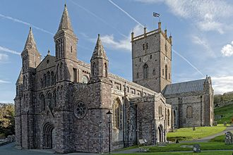 St David's Cathedral - West end, nave south transept and tower flying the dean's flag