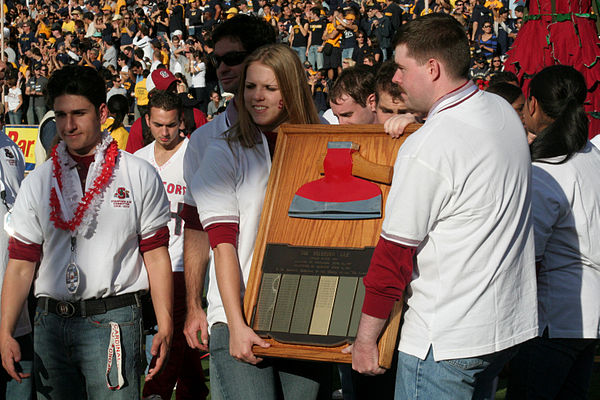 Stanford University's Axe Committee carries the Axe around Memorial Stadium during the 2008 Big Game Stanford Axe.jpg