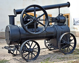 Portable engine - A portable engine, preserved at the museum in Blankenhain Castle, Germany. The chimney has been folded-down, ready for transporting the engine to a new location. The axle under the smokebox (on the left) pivots to allow the engine to be steered. Towing eyes are provided on the same axle assembly to allow the engine to be pulled along.