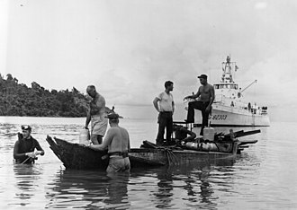 USCGC Point Young (WPB-82303) - Point Young acts as support vessel for Navy divers and Coast Guard personnel working to raise the first Viet Cong junk that was sunk in the Gulf of Thailand by a Coast Guard Point-class cutter, September 1965.