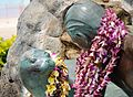 Surfer Boy and Seal Statue - Waikiki (7016755197).jpg