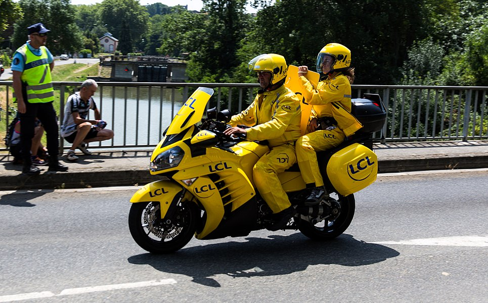 LCL motorbike behind the breakaway, carrying Claire Pedrono, the official time board of the Tour de France.