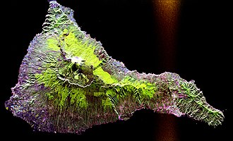 Imaging radar - An SAR radar image acquired by the SIR-C/X-SAR radar on board the Space Shuttle Endeavour shows the Teide volcano. The city of Santa Cruz de Tenerife is visible as the purple and white area on the lower right edge of the island. Lava flows at the summit crater appear in shades of green and brown, while vegetation zones appear as areas of purple, green and yellow on the volcano's flanks.