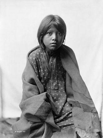Taos art colony - Edward S. Curtis, A Taos girl, three-quarter length portrait, seated, facing front, ca. 1905