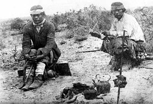 Tehuelche people - Tehuelches drinking mate while the meat of the asado is roasting, 1895