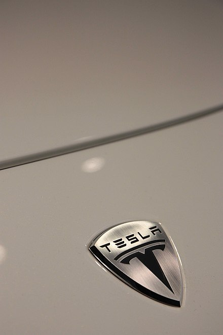 The insignia of Tesla Motors as seen on a Tesla Roadster Sport - Tesla Motors