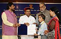 Thaawar Chand Gehlot presenting the awards to the winners of 'Drawing and Painting Competition' for student including students with disabilities (1).jpg