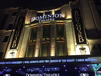 Dominion Theatre - The restored facade, as seen in 2017, illuminated at night.