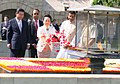The Chinese President, Mr. Xi Jinping and the First Lady of the Republic of China, Ms. Peng Liyuan paying floral tributes at the Samadhi of Mahatma Gandhi, at Rajghat, in Delhi on September 18, 2014.jpg