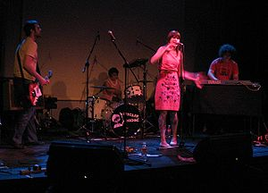 The Grates - The Grates, performing at Main Hall, Montreal in June 2006. (L to R): John Patterson, Alana Skyring, Patience Hodgson, Dan Condon.