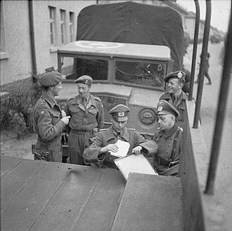 Bergen-Belsen concentration camp - British and German officers finalize the arrangements for the ending of their temporary truce, April 1945