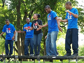 "The Bronx's P.L.A.Y.E.R.S. Club Steppers performing at the 2007 Fort Greene Park Summer Literary Festival in Brooklyn. (Note the T-shirts' inscription ""I BX"" [Bronx], echoing the ubiquitous slogan ""I NY"" [I Love New York] ). The PLAYERS Club Steppers by David Shankbone.jpg"