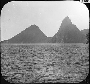 Flag of Saint Lucia - A 1903 image of the Pitons, the two conical volcanic edifices that are stylised as the two central triangles of the flag.