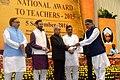 The President, Shri Pranab Mukherjee presenting the National Award for Teachers-2015 to Shri Naresh Kumar Shastri (Himachal Pradesh), on the occasion of the 'Teachers Day', in New Delhi.jpg