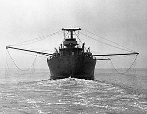 Torpedo net - Ship with deployed torpedo nets in the Second World War