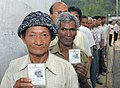 The voters displaying their identity cards at a polling station, Tippi, Arunachal Pradesh, during General Elections-2009 on April 16, 2009.jpg