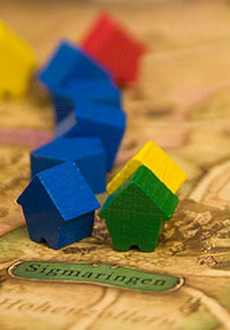 Thurn and Taxis (board game) - Game board detail showing a city (Sigmaringen), roads leading from it, and a number of player markers. The middle three blue markers have not been placed on cities as they would be in an actual game.