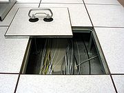 Tile-lifter-in-use-raised-floor