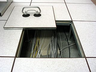 Raised floor elevated floor above a solid substrate to create a void for mechanical and electrical services