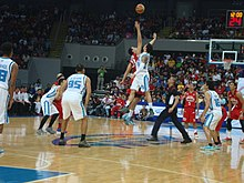 141c4a1e5b79 Manila Clasico - Tipoff between Marc Pingris of San Mig Coffee and Greg  Slaughter of Barangay