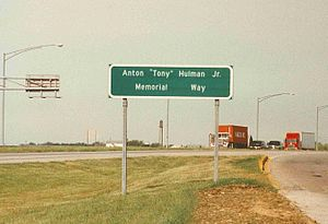 "Tony Hulman - Roadway sign located at a rest stop on Interstate 70 in Indiana depicting the Anton ""Tony"" Hulman Jr. Memorial Way"