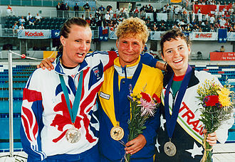 1996 Summer Paralympics - Eila Nilsson of Sweden celebrating her 50 m freestyle B1 gold with Janice Burton of Great Britain and Tracey Cross of Australia.
