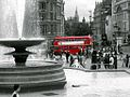 Trafalgar Square fountain, Whitehall, and Routemaster, London, 3 November 2005.jpg