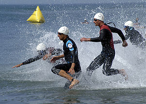 Multisport race - Triathletes begin the swimming stage of the 12th World Military Triathlon.