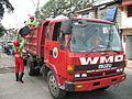 Trucks collect garbage in Valenzuela City.jpg