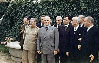 Potsdam Conference - Joseph Stalin and Harry Truman meeting at the Potsdam Conference on 18 July 1945. From left to right, first row: Premier Joseph Stalin; President Harry S. Truman, Soviet Ambassador to the United States Andrei Gromyko, Secretary of State James F. Byrnes, and Soviet Foreign Minister Vyacheslav Molotov. Second row: Brigadier General Harry H. Vaughan, Truman's confidant and military aide, Russian interpreter Charles Bohlen, Truman naval aide James K. Vardaman, Jr., and (partially obscured) Charles Griffith Ross.