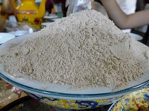Tsampa - A bowl of unprepared Tsampa, served on the table of a Tibetan restaurant in Chengdu, China.