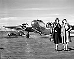 Two Models in front of a Lockheed 10B Electra, Delta Air Lines (11429451424).jpg