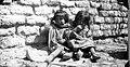 Two girls leaning against an adobe wall. Catamarca. 1926. (3568193798).jpg