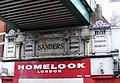 Two shop signs under railway bridge - geograph.org.uk - 1130820.jpg