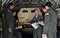 U.S. Air Force Capt. David Tomlinson, center, a C-17 Globemaster III aircraft pilot with the 8th Airlift Squadron, gives a final crew brief prior to takeoff with motorcycles and M142 light multiple rocket 130425-F-IO684-576.jpg