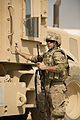 U.S. Air Force Master Sgt. Adrian Roth, assigned to the 577th Expeditionary Prime Base Engineer Emergency Force Squadron, dismounts from a vibratory road roller in Payan Janqadam near Bagram Airfield 130613-F-YL744-189.jpg