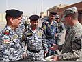 U.S. Army Lt. Col Cameron Cantlon, right, discusses possible upcoming training events with Iraqi Federal Police Maj. Gen. Baha'a, left, commander of the 4th Iraqi Federal Police Division, and members of his unit 110324-A-LP895-001.jpg