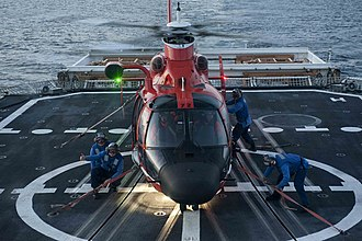 USCGC Bertholf - Image: U.S. Coast Guard flight deck crew members aboard maritime security cutter USCGC Bertholf (WMSL 750) tie down an MH 65 Dolphin helicopter arriving from Coast Guard Air Station Los Angeles to the deck to secure it 120822 G VS714 324