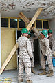 U.S. Marines with the 9th Engineer Support Battalion set up support braces for a concrete awning during a renovation project at Erdmiin Oyun High School in the Nalaikh district of Ulaanbaatar, Mongolia, July 20 130720-M-DR618-128.jpg