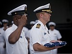 U.S. Navy Capt. Kent Whalen, right foreground, the commanding officer of the aircraft carrier USS Carl Vinson (CVN 70), holds a U.S. flag during a burial at sea aboard the ship June 28, 2013, in the Pacific 130628-N-GZ277-507.jpg