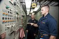 U.S. Navy Chief Warrant Officer 3 Tony Daneault, left, watches Ensign Matthew Clark during a spot-check in the main engine room aboard the guided missile cruiser USS Gettysburg (CG 64) in the Gulf of Oman 131216-N-PL185-032.jpg